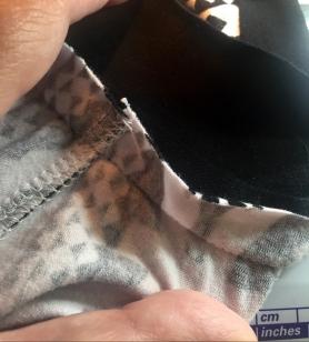 folding trim strip over seam and stitching