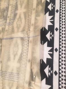 Skirt pattern pinned straight along stripe