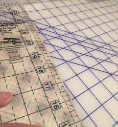 Cutting napkin in half on fold