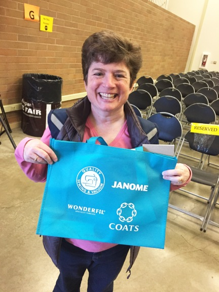 Attendee with bag